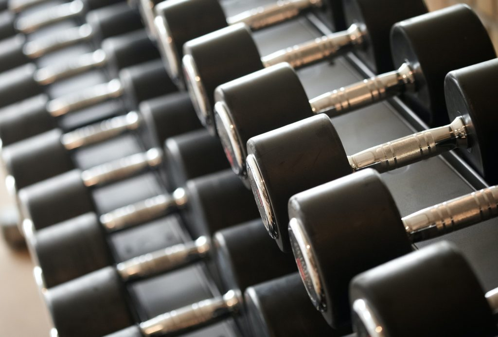 Closeup image of dumbells on a stand. Gym equipment